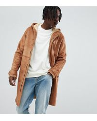 The New County Longline Coat In Faux Shearling