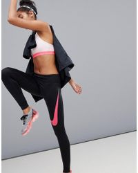 Nike - Power Essential Dri-fit Leggings In Black With Pink Swoosh - Lyst