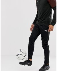 27bd94300b9f PUMA Football Evotrg Training Tech Pants In Black 65536106 in Black ...