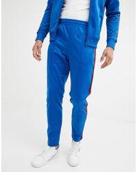Benetton - Pantalones de chndal con cinta en azul de - Lyst