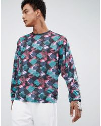 50a5bd99 ASOS - Batwing Long Sleeve T-shirt With All Over Retro Geo Print - Lyst