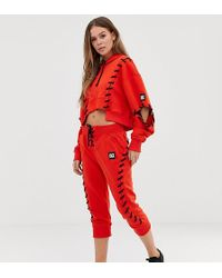 Ivy Park - Joggers rojos con cordones de - Lyst