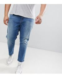 ASOS - Asos Plus Tapered Jeans In Mid Wash Blue - Lyst