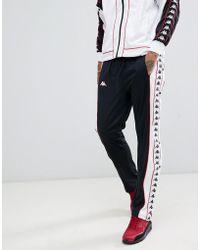 Kappa - Schwarze Jogginghose mit seitlichem Druckknopfverschluss und Logoband - Lyst