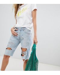 Reclaimed (vintage) - Revived Longer Length Levis Shorts With Extreme Rips - Lyst