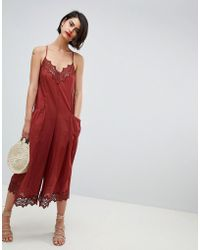 2782949096 ASOS - Jumpsuit With Lace Trims And Oversized Pocket Detail - Lyst