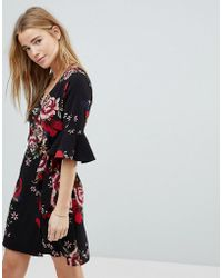Girls On Film - Floral Wrap Dress With Fluted Sleeve - Lyst