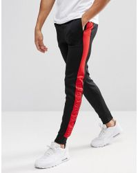 Kings Will Dream - Skinny Joggers In Black With Red Stripe - Lyst