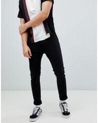 Wrangler - Super Skinny Jeans Black - Lyst