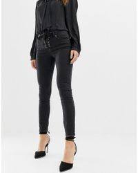 ASOS - Whitby Low Rise Skinny Jeans In Washed Black With Lace Up Front Detail - Lyst