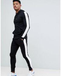 ASOS - Survtement avec hoodie moulant et pantalon de jogging ultra ajust bande sur le ct - Lyst