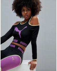 PUMA - Exclusive To Asos Long Sleeve Cut Out Crop In Black - Lyst