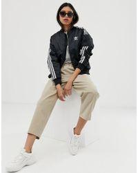 87b6e8cccccd9 adidas Originals - Locked Up Trefoil Three Stripe Track Jacket In Black -  Lyst