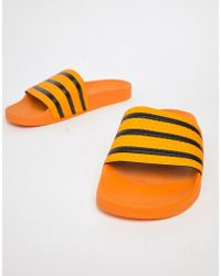 adidas Originals - Adilette Sliders In Yellow Cq3099 - Lyst