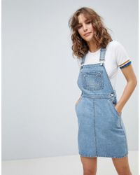 4e7e8073465 ASOS - Denim Dungaree Dress In Vintage Blue - Lyst