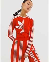 a9445b7205ad adidas Originals - X Ji Won Choi High Neck Three Stripe Body In Red - Lyst