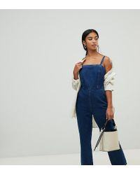 ASOS - Asos Design Petite Denim Jumpsuit With Strappy Back In Midwash Blue - Lyst