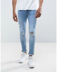 River Island - Skinny Jeans With Rips In Blue Wash - Lyst