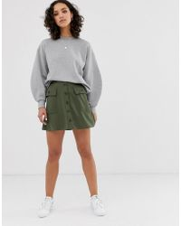 ASOS - Button Front Mini Skirt With Pockets - Lyst