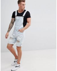 ASOS - Design Denim Short Dungarees In Light Wash Blue With Heavy Rips - Lyst