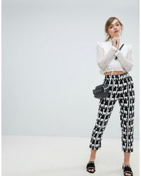 Sister Jane - Cigarette Trousers With Front Stripe In All Over Llama Print - Lyst
