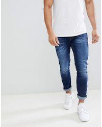 River Island - Skinny Jeans In Dark Blue Wash - Lyst