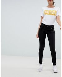 Urban Bliss - Skinny Jeans With Stud Pocket - Lyst