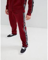 DC Shoes - Pantalon de jogging avec bandes logo - Lyst