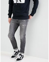 Calvin Klein - Skinny Jeans With Rip And Repair - Lyst