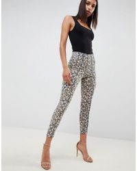 d99446f8a ASOS - Ridley High Waist Corset Skinny Jeans In Leopard Print With Cross  Stitch Detail -