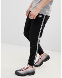 Nike - Taping Skinny Fit Joggers In Black Ar4912-010 - Lyst