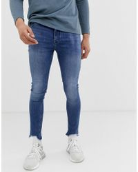 ASOS Spray On Jeans In Power Stretch With Raw Hem In Blue