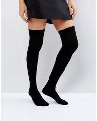 5791c7a793a Lyst - American Apparel Thigh High Striped Sock in Black
