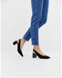 Stradivarius Zapatos con tira trasera en negro