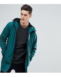 ASOS - Tall Shower Resistant Rain Coat With Borg Lined Hood In Bottle Green - Lyst
