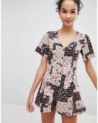 ASOS - Design Swing Playsuit With Button Front In Patchwork Floral Print - Lyst