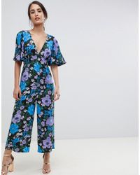 bbb81de9b17 ASOS - Tea Jumpsuit With Empire Seam And Flutter Sleeve In Floral Print -  Lyst