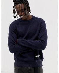 Calvin Klein Pull ras de cou en laine mélangée avec logo - Bleu