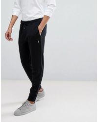 5c4286b28f7fda Polo Ralph Lauren - Pantalon de jogging ajust resserr aux chevilles avec  logo joueur de polo