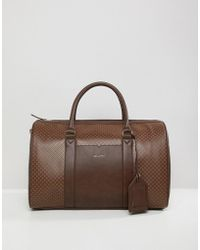 ASOS - Holdall In Brown Print With luggage Tag - Lyst