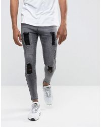 Illusive London - Super Skinny Jeans In Acid Wash Black With Distressing - Lyst
