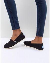 TOMS - Zapatos de lona clásicos en negro - Lyst
