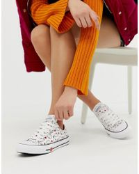 4e35bb800b19 Converse - X Hello Kitty Chuck Taylor Ox White All Over Print Sneakers -  Lyst