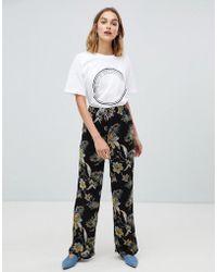 Gestuz - Maui Floral Print Wide Leg Trousers - Lyst