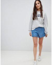 Vila - Ruffle Hem Denim Shorts - Lyst