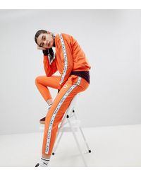 PUMA - Exclusive To Asos Taped Side Stripe Track Trousers In Orange - Lyst
