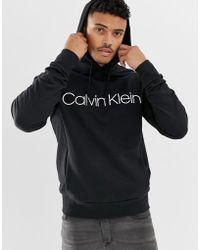 Calvin Klein - Felpa con cappuccio nera - Lyst