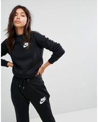 ba144079cff3 Nike Exclusive To Asos Rally Sweatshirt In Blue in Blue - Lyst