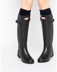 HUNTER - Stivali da pioggia neri con cinturino posteriore - Lyst
