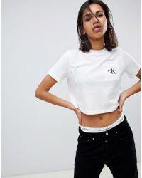50ef25c9 Calvin Klein - Cropped T Shirt With Pocket Logo - Lyst